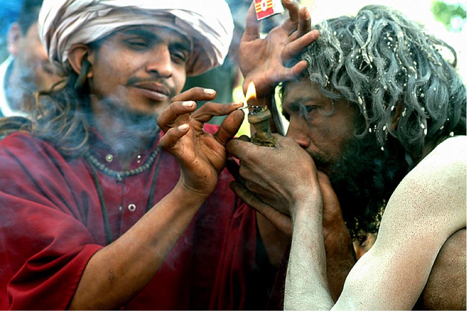 Indian smoking a chillum